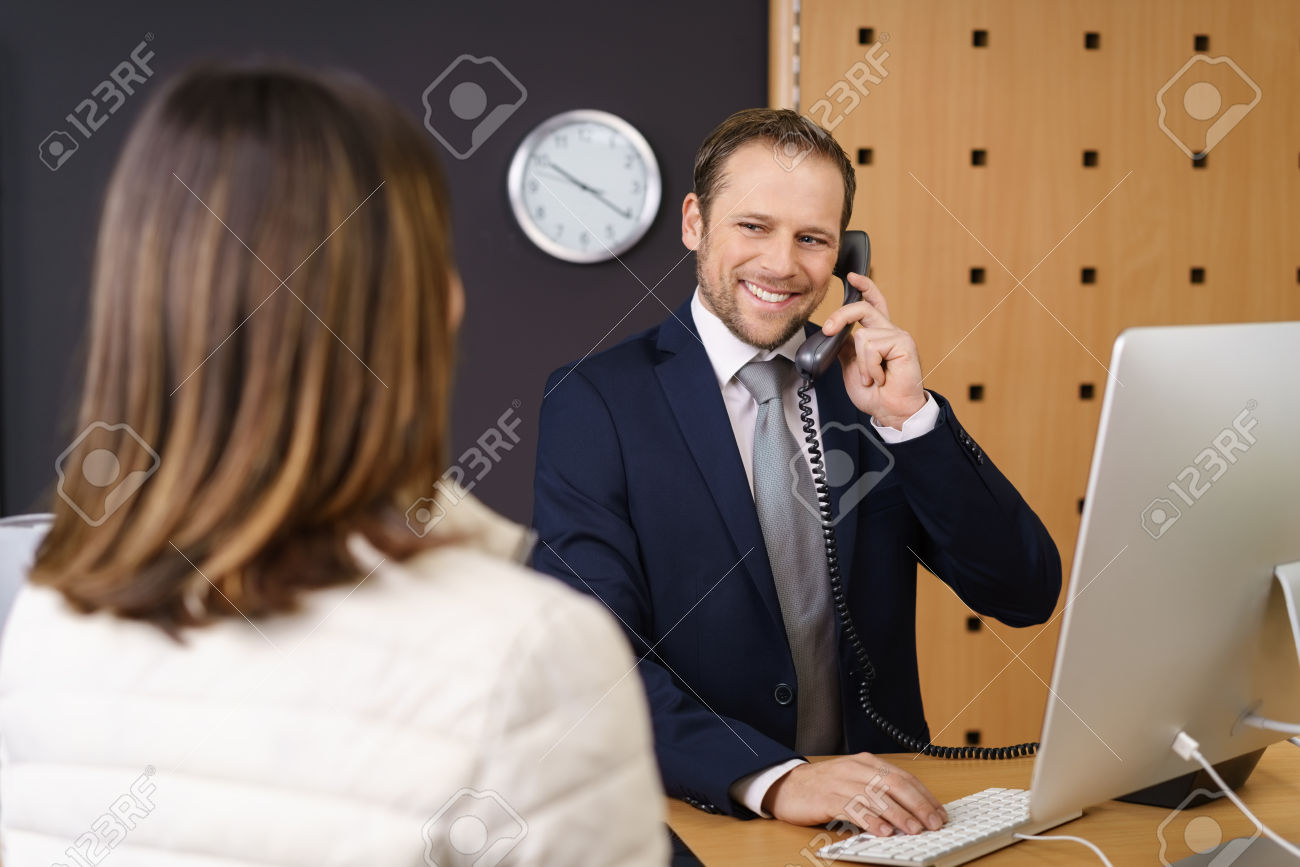 Hotel manager smiling at a female client