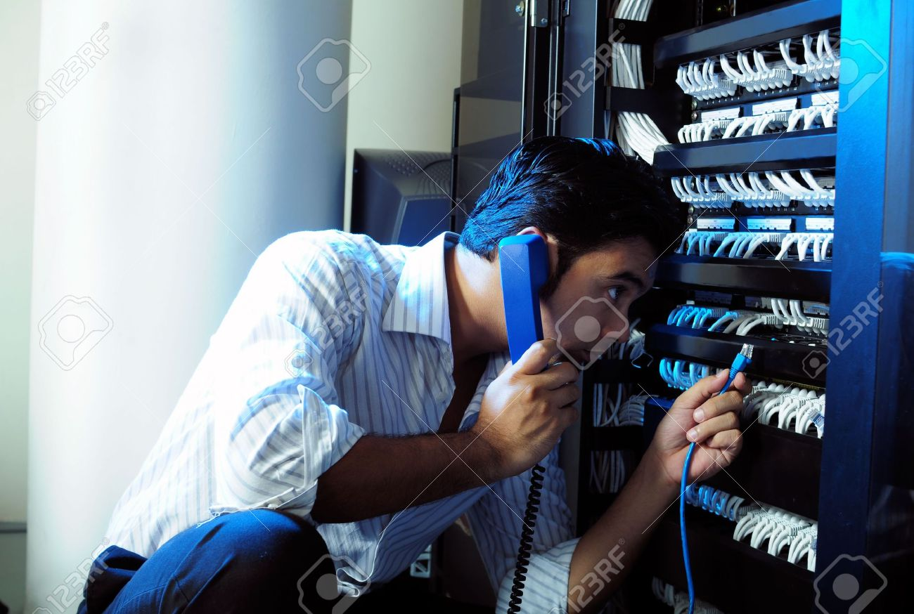 4256192-IT-system-administrator-Stock-Photo-server-system-telephone
