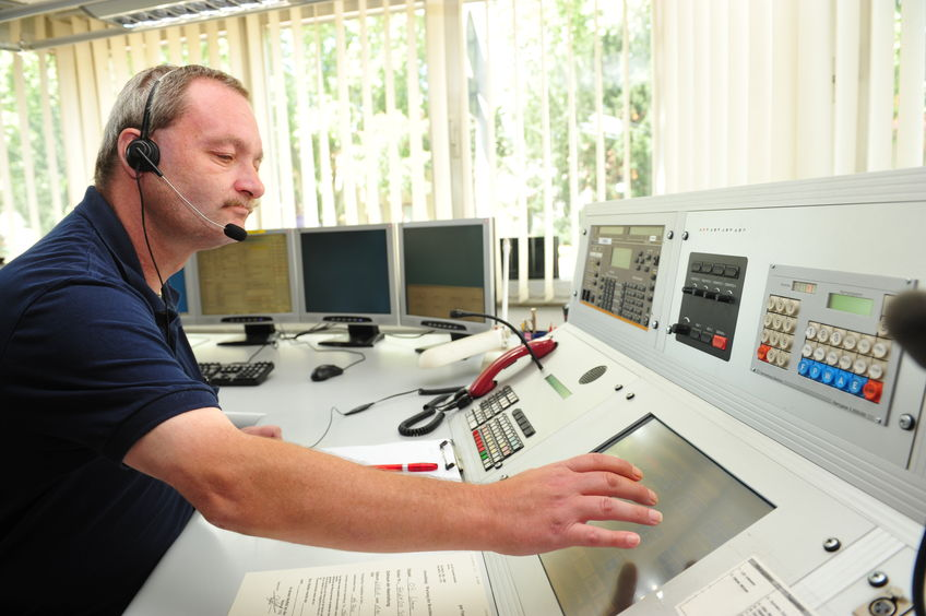 45212457 - worms, germany - jule 21, 2009 - fire fighter in control room of fire department worms taking an emergency call
